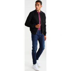 GStar ARC 3D SLIM Jeansy Slim Fit devon denim. Niebieskie jeansy męskie relaxed fit marki G-Star, z bawełny. W wyprzedaży za 383,40 zł.