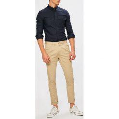 Calvin Klein Jeans - Spodnie. Szare chinosy męskie Calvin Klein Jeans, z haftami, z bawełny. W wyprzedaży za 319,90 zł.