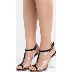 Czarne Sandały Beautiful Birds. Czarne sandały damskie na słupku marki Born2be, z materiału, na wysokim obcasie. Za 89,99 zł.
