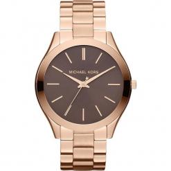 """Zegarek kwarcowy """"Slim Runway"""" w kolorze brązowo-różowozłotym. Żółte, analogowe zegarki damskie marki Michael Kors, ze stali. W wyprzedaży za 413,95 zł."""