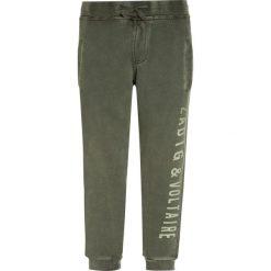 Zadig & Voltaire Spodnie treningowe kaki. Brązowe spodnie chłopięce marki Zadig & Voltaire, z bawełny. W wyprzedaży za 202,30 zł.