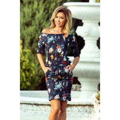 MONIC Sukienka sportowa - KOLOROWE KWIATY na granatowym tle. Niebieskie sukienki hiszpanki numoco, s, w kolorowe wzory, sportowe, sportowe. Za 149,99 zł.
