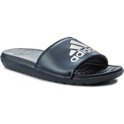 Klapki adidas - Voloomix CP9448  Conavy/Silvmt/Conavy. Niebieskie chodaki męskie Adidas, z materiału. Za 99,00 zł.