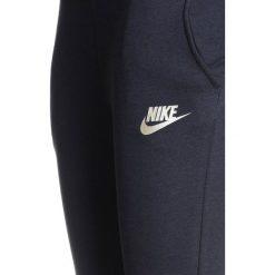Nike Performance PANT Spodnie treningowe black/black. Czarne spodnie chłopięce marki Nike Performance, z bawełny. W wyprzedaży za 170,10 zł.