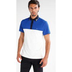 J.LINDEBERG JOHAN SLIM TOURQUE Koszulka polo strong blue. Niebieskie koszulki polo J.LINDEBERG, m, z materiału. W wyprzedaży za 208,45 zł.