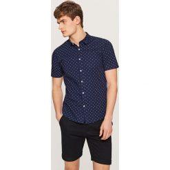 Koszula z mikroprintem slim fit - Granatowy. Niebieskie koszule męskie slim marki Reserved, l. Za 69,99 zł.
