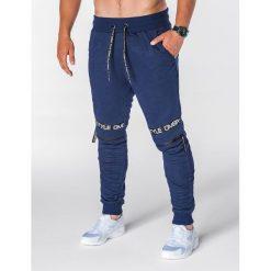 SPODNIE MĘSKIE DRESOWE P637 - GRANATOWE. Niebieskie spodnie dresowe męskie Ombre Clothing, z aplikacjami, z bawełny. Za 49,00 zł.