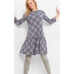Trapezowa sukienka w kratę. Brązowe sukienki dzianinowe marki Orsay, s. Za 89,99 zł.