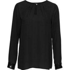 Bluzka bonprix czarny. Czarne bluzki asymetryczne bonprix, eleganckie. Za 74,99 zł.