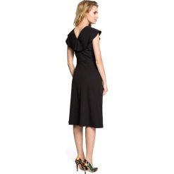 ROCHELLE Sukienka rozkloszowana z falbankami przy rękawach - czarna. Czarne sukienki balowe Moe, na imprezę, s, z falbankami, mini, dopasowane. Za 136,99 zł.
