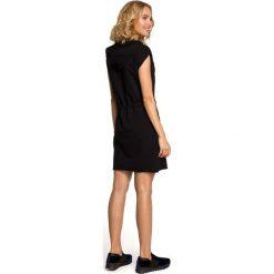 JULIET Mini sukienka dresowa z kapturem - czarna. Czarne sukienki dresowe Moe, sportowe, z kapturem, z krótkim rękawem, mini, sportowe. Za 136,99 zł.