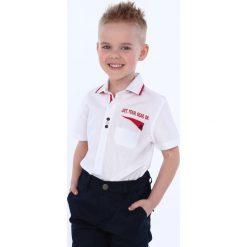 Koszula chłopięca biała z czerwonymi elementami NDZ7497. Białe koszule chłopięce Fasardi. Za 49,00 zł.