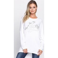 Biała Tunika Be Genial. Białe tuniki damskie z długim rękawem marki Born2be, m, z napisami, z okrągłym kołnierzem. Za 49,99 zł.