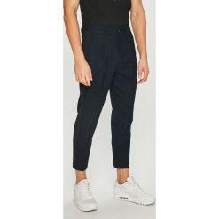 Jack & Jones - Spodnie. Czarne chinosy męskie marki Jack & Jones, l, z bawełny, z okrągłym kołnierzem. Za 259,90 zł.