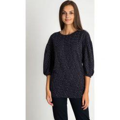 Czarna bluzka z błyszczącą nitką QUIOSQUE. Czarne bluzki longsleeves marki QUIOSQUE, l, w paski, z dzianiny. W wyprzedaży za 39,99 zł.