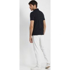 Lacoste Koszulka polo marine/blanc. Szare koszulki polo marki Lacoste, z bawełny. Za 429,00 zł.