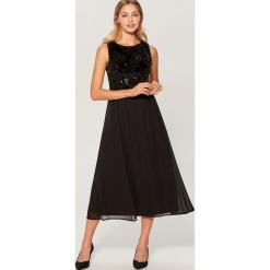 Elegancka sukienka z cekinowym topem - Czarny. Białe sukienki balowe marki numoco, do pracy, l, z nadrukiem, z elastanu, z kopertowym dekoltem, z długim rękawem, kopertowe. Za 179,99 zł.
