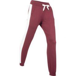 Spodnie dresowe damskie: Spodnie bawełniane dresowe, długie bonprix bordowy