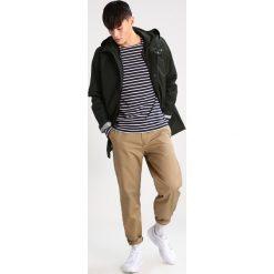 Spodnie męskie: Carhartt WIP STATION DUNMORE Chinosy leather rinsed