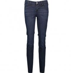 """Dżinsy """"Jasmin"""" - Slim fit - w kolorze granatowym. Niebieskie spodnie z wysokim stanem marki Mustang, z aplikacjami, z bawełny. W wyprzedaży za 173,95 zł."""