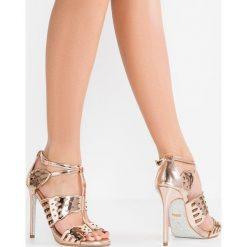 Rzymianki damskie: Carvela GIVE Sandały na obcasie bronze