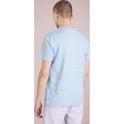 J.LINDEBERG PRIMO  Tshirt basic blue melange. Niebieskie koszulki polo marki Tiffosi. Za 249,00 zł.