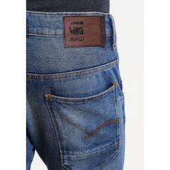 GStar ARC 3D SLIM Jeansy Slim fit tobe denim. Białe jeansy męskie relaxed fit marki G-Star, z nadrukiem. W wyprzedaży za 439,20 zł.