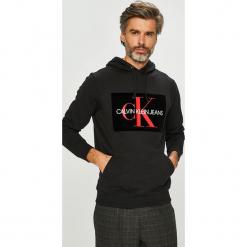 Calvin Klein Jeans - Bluza. Czarne bejsbolówki męskie Calvin Klein Jeans, l, z nadrukiem, z bawełny, z kapturem. Za 499,90 zł.