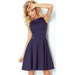 98-1 sukienka koło - dekolt łódka - gruba lacosta granatowa. Niebieskie sukienki na komunię marki numoco, l, z dekoltem w łódkę, rozkloszowane. Za 139,00 zł.