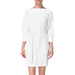 Sukienka w kolorze białym. Białe sukienki mini marki BOHOBOCO, w paski, z tkaniny, z dekoltem na plecach, proste. W wyprzedaży za 909,95 zł.