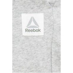 Reebok - Spodnie. Szare bryczesy damskie marki Reebok, l, z dzianiny, casualowe, z okrągłym kołnierzem. W wyprzedaży za 119,90 zł.