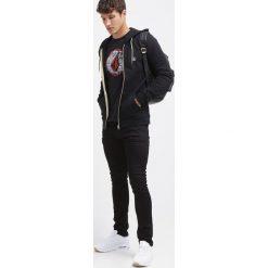 Volcom Jeansy Slim Fit black on black. Czarne jeansy męskie Volcom. Za 339,00 zł.