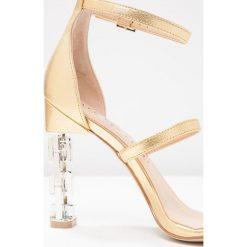 Katy Perry VILAN Sandały na obcasie gold. Brązowe sandały damskie marki Etro. W wyprzedaży za 463,20 zł.