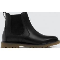 Buty męskie: Czarne skórzane botki z gumką