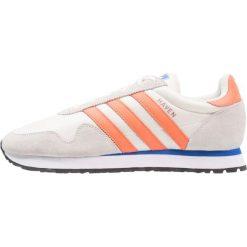 Adidas Originals HAVEN Tenisówki i Trampki chalk white/trace orange/offwhite. Szare tenisówki damskie marki adidas Originals, z gumy. Za 399,00 zł.