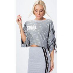 Bluza krótka z dziurami szara 6480. Szare bluzy damskie Fasardi, l, z krótkim rękawem, krótkie. Za 39,00 zł.