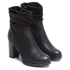 Botki w kolorze czarnym. Czarne buty zimowe damskie Carla Samuel, na zimę. W wyprzedaży za 129,95 zł.