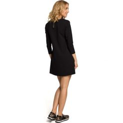 LENA Mini sukienka – tunika z kieszenią w kształcie serca - czarna. Czarne sukienki mini marki DOMYOS, z bawełny, street. Za 99,00 zł.