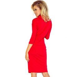 Chantal Sukienka sportowa z golfem - czerwona. Czerwone sukienki sportowe numoco, z wiskozy, z golfem, sportowe. Za 110,00 zł.