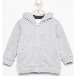 Bluza z kapturem - Jasny szar. Szare bluzy niemowlęce marki Reserved, z kapturem. Za 24,99 zł.