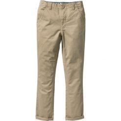 Spodnie chino Skinny Fit bonprix jasny khaki. Brązowe spodnie chłopięce bonprix. Za 37,99 zł.