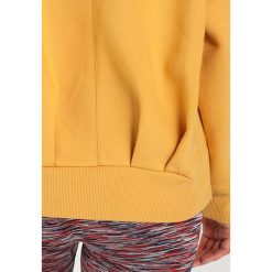 Bluzy rozpinane damskie: adidas by Stella McCartney Bluza toagol