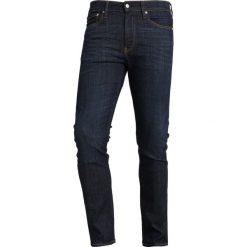 Calvin Klein Jeans 026 SLIM Jeansy Slim Fit denim. Niebieskie jeansy męskie relaxed fit Calvin Klein Jeans. Za 509,00 zł.