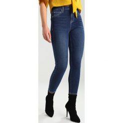 Topshop CONTRAST JAMIE Jeans Skinny Fit indigo. Niebieskie jeansy damskie marki Topshop, z bawełny. Za 229,00 zł.