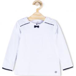 Koszulka. Białe bluzki dziewczęce bawełniane marki ELEGANT BABY GIRL, z kokardą, z długim rękawem. Za 39,90 zł.