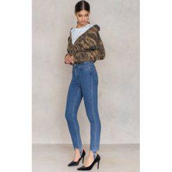 NA-KD Spodnie jeansowe Stirrup - Blue. Niebieskie spodnie z wysokim stanem marki NA-KD, z bawełny. W wyprzedaży za 40,19 zł.