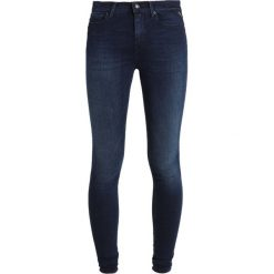 Replay JOI PANTS Jeans Skinny Fit dark blue denim. Niebieskie jeansy damskie relaxed fit marki Replay. Za 559,00 zł.