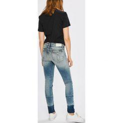 Calvin Klein Jeans - Jeansy. Niebieskie jeansy damskie rurki Calvin Klein Jeans, z bawełny. W wyprzedaży za 429,90 zł.
