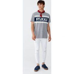 Jeansy rurki z przetarciami. Czarne jeansy męskie z dziurami marki Pull&Bear, m. Za 96,90 zł.
