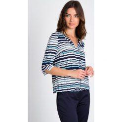 Bluzki damskie: Geometryczna bluzka z dekoltem V QUIOSQUE